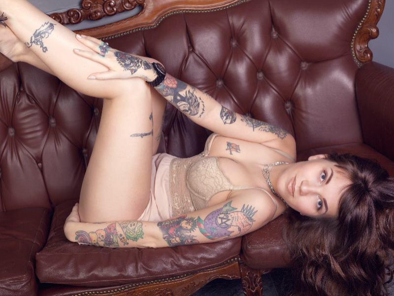 Tattooed KInky Girl Stripping